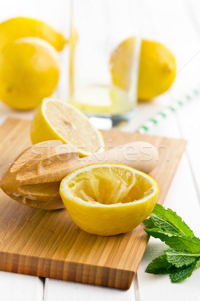squeezed lemon fruit and citrus reamer Stock photo © jirkaejc