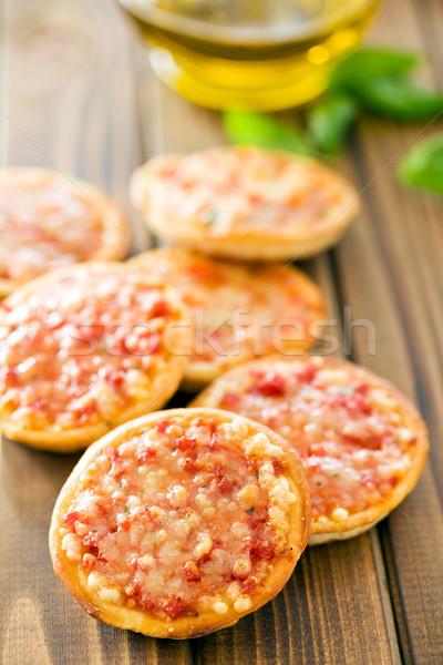 Mini pizza tavolo in legno pane formaggio pranzo Foto d'archivio © jirkaejc