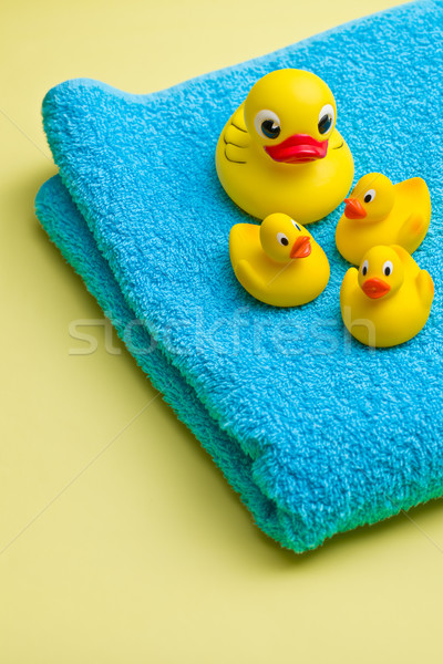 yellow bath duck on blue towel Stock photo © jirkaejc