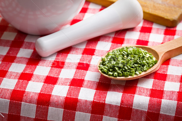 ​​green chives in wooden spoon Stock photo © jirkaejc