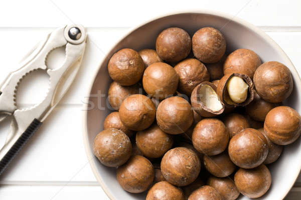 macadamia nuts with nutcracker Stock photo © jirkaejc
