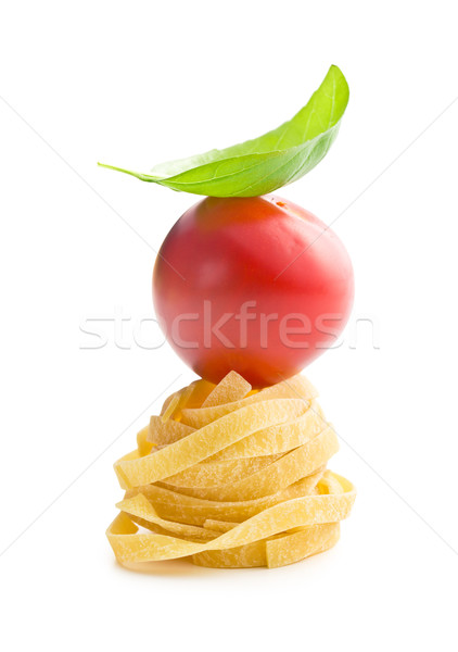 Italiaans pasta tagliatelle tomaat basilicum blad Stockfoto © jirkaejc