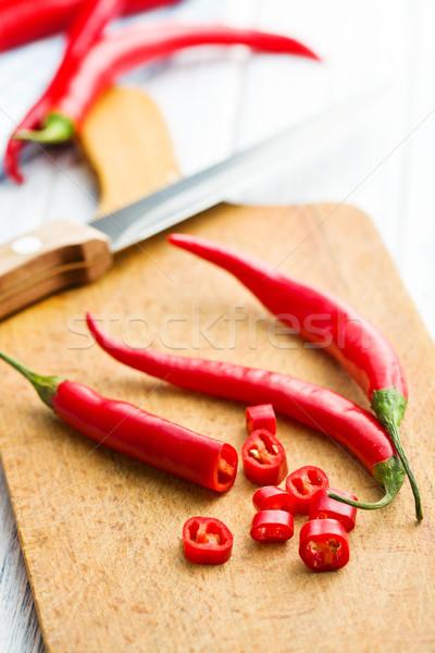 chili peppers on cutting board Stock photo © jirkaejc