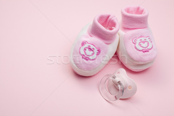 pink baby shoes and pacifier Stock photo © jirkaejc
