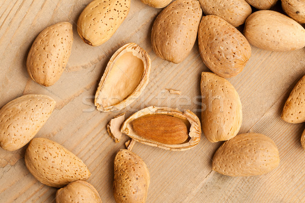 Stock photo: almonds in nutshell