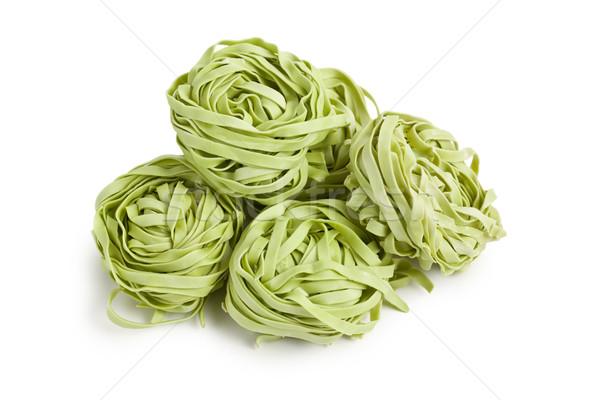 Zöld tészta tagliatelle fehér háttér konyha Stock fotó © jirkaejc