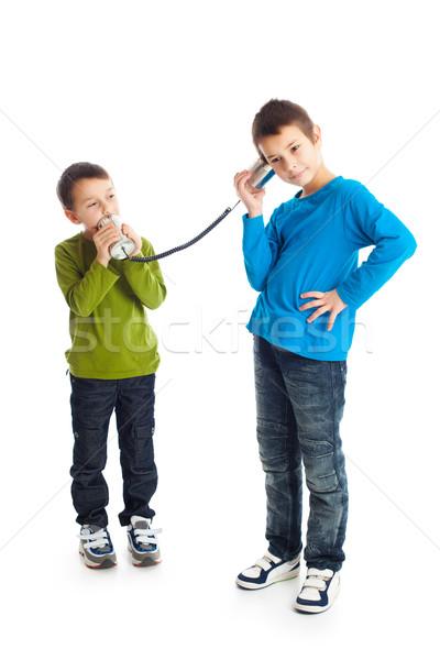 Two boys calling tin can phone. Stock photo © jirkaejc