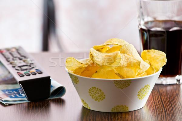 хрустящий картофельные чипсы пультом есть картофеля Cut Сток-фото © jirkaejc