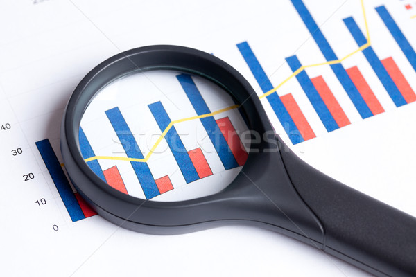 magnifying glass focusing on business graph Stock photo © jirkaejc