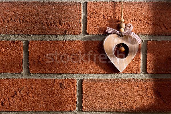 wooden heart hanging on brick wall Stock photo © jirkaejc