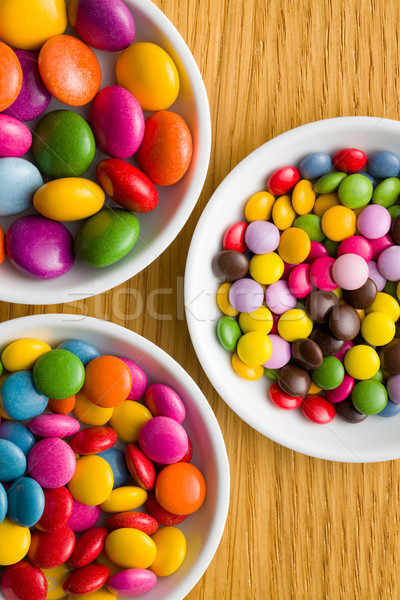 Three different sizes of colorful candies Stock photo © jirkaejc
