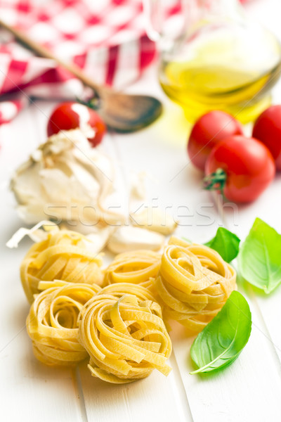 italian pasta tagliatelle, tomatoes and basil leaves Stock photo © jirkaejc