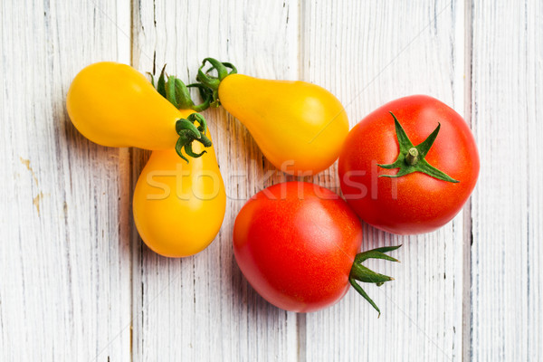 Stock photo: various tomatoes on wooden table