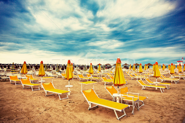 sunbeds and parasols on the beach Stock photo © jirkaejc