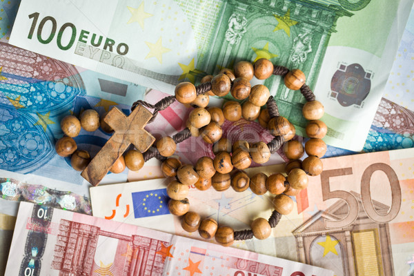 rosary beads on euro bills Stock photo © jirkaejc
