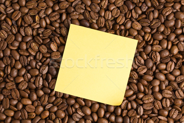 yellow note paper on coffee beans background Stock photo © jirkaejc
