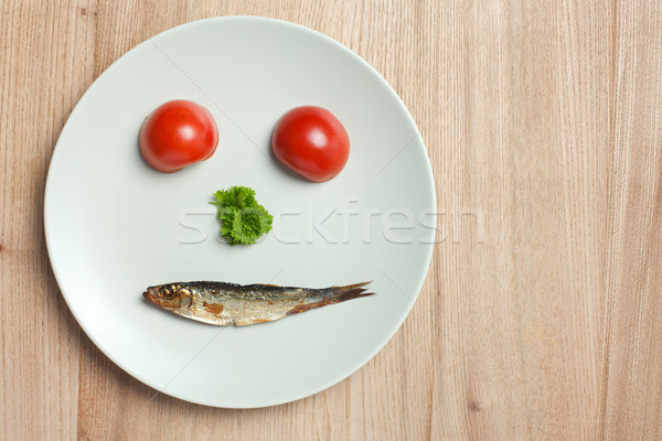 face maked with vegetable and sprat Stock photo © jirkaejc