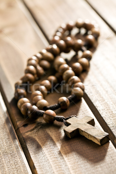 rosary beads on wooden background Stock photo © jirkaejc