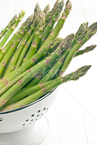 green asparagus in colander Stock photo © jirkaejc