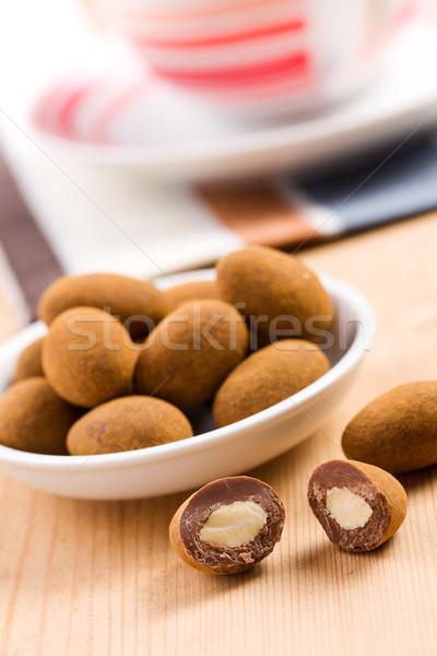 almonds in chocolate with cinnamon Stock photo © jirkaejc