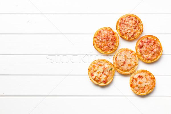 Mini pizza üst görmek ahşap masa ekmek Stok fotoğraf © jirkaejc