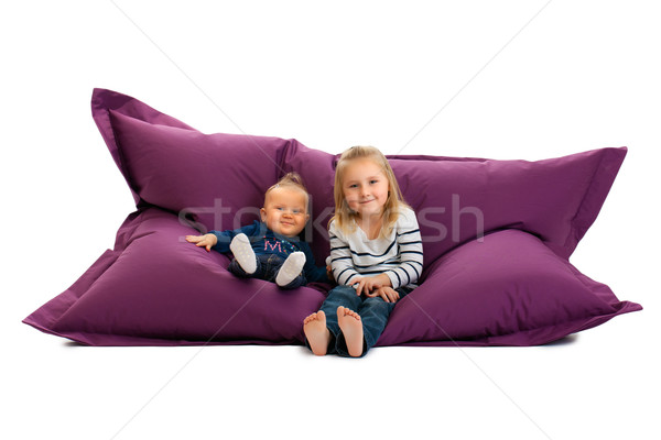 two sister sitting on beanbag Stock photo © jirkaejc