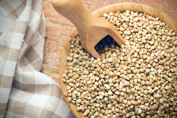 uncooked buckwheat in wooden bowl Stock photo © jirkaejc