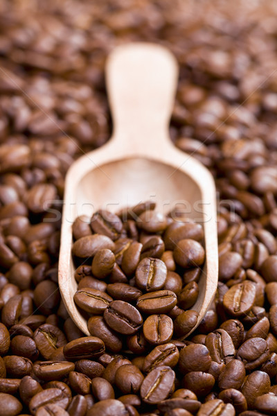 coffee beans on wooden scoop Stock photo © jirkaejc