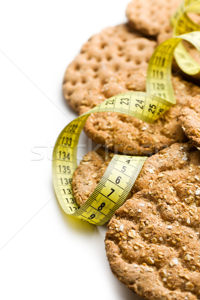 Crispbread with measuring tape Stock photo © jirkaejc