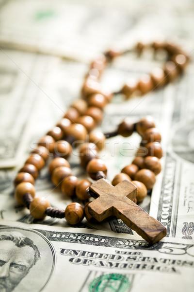 rosary beads on us dollars Stock photo © jirkaejc