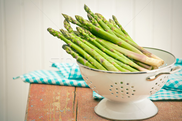 green asparagus in colander Stock photo © jirkaejc