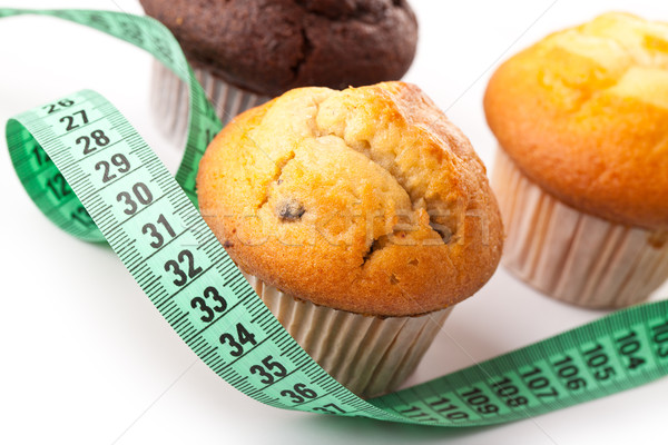 muffins with measuring tape Stock photo © jirkaejc