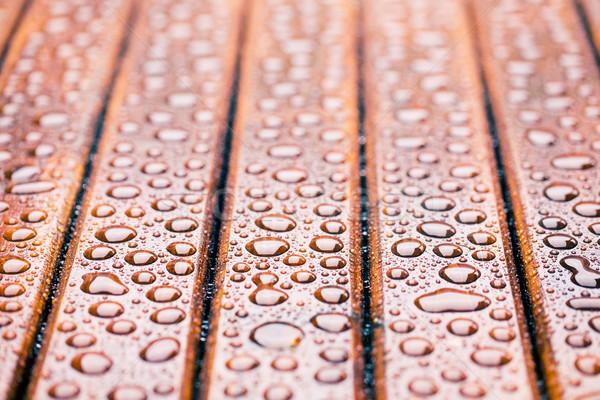 water drops on wooden garden table Stock photo © jirkaejc