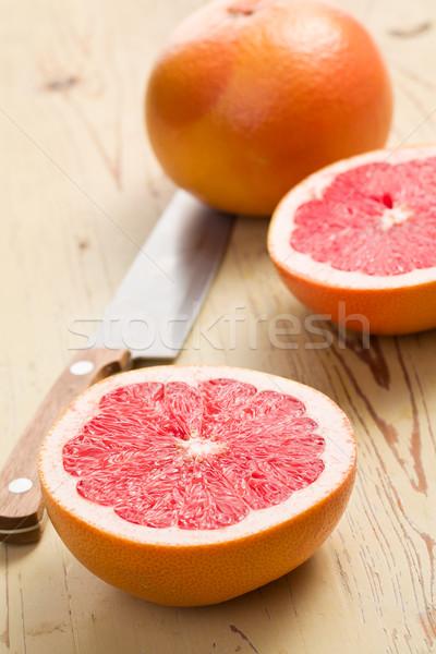 Szeletel piros grapefruit konyhaasztal szín bőr Stock fotó © jirkaejc