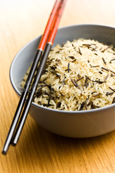 wild rice in ceramic bowl and chopsticks Stock photo © jirkaejc