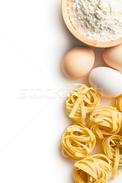 Italian pasta tagliatelle, eggs and flour Stock photo © jirkaejc