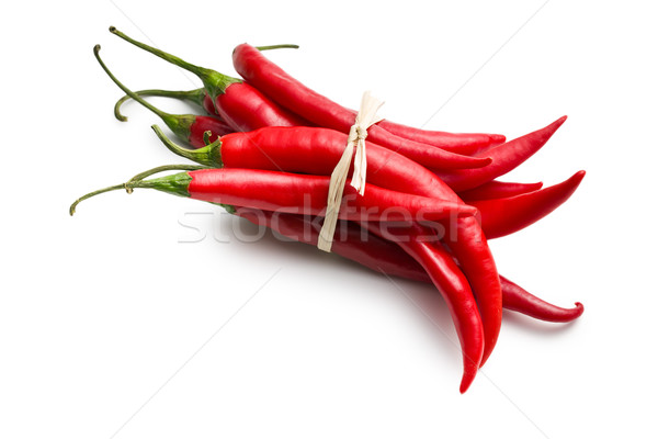 tied chili peppers on white background Stock photo © jirkaejc