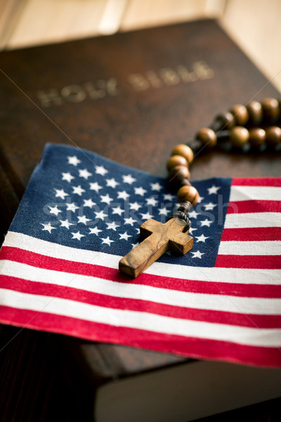holy bible with american flag and crucifix Stock photo © jirkaejc