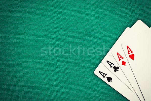 four aces on green casino table Stock photo © jirkaejc