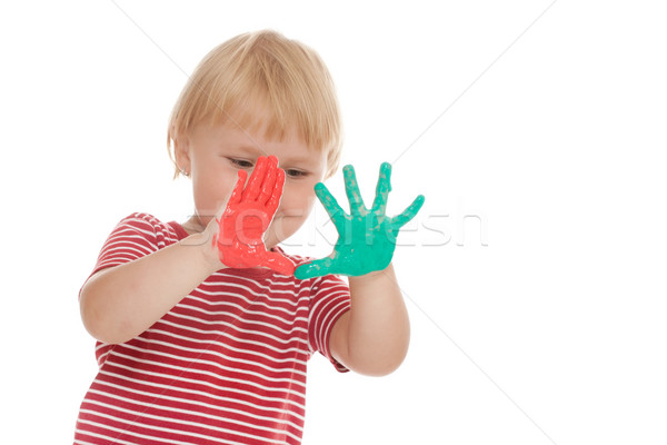 little girl with colorful hands Stock photo © jirkaejc