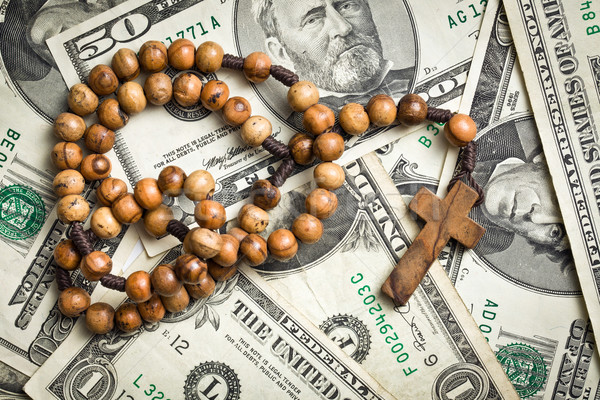 rosary beads on us dollars Stock photo © jirkaejc