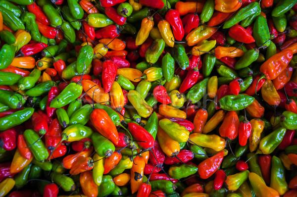 Színes chilipaprika piros narancs citromsárga zöld Stock fotó © jkraft5
