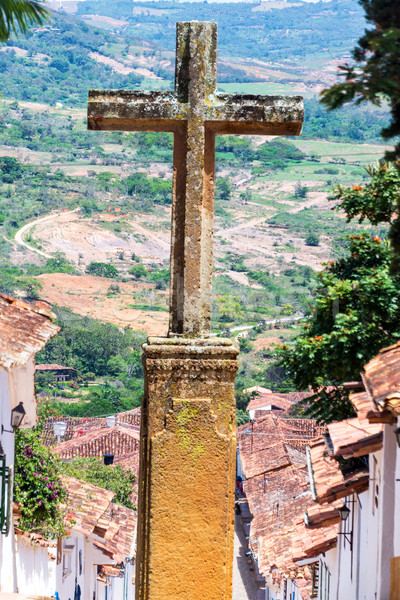 Stock photo: Stone Cross and Colonial Town