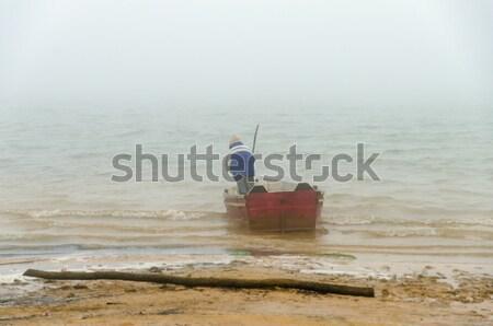 Kano kötü hava adam göl kıyı su Stok fotoğraf © jkraft5
