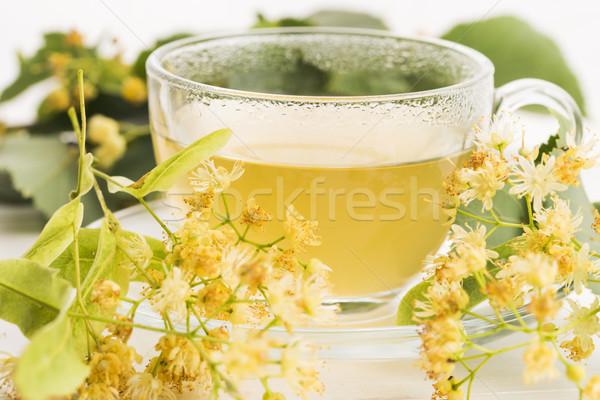 Tetera taza té flores cielo Foto stock © joannawnuk