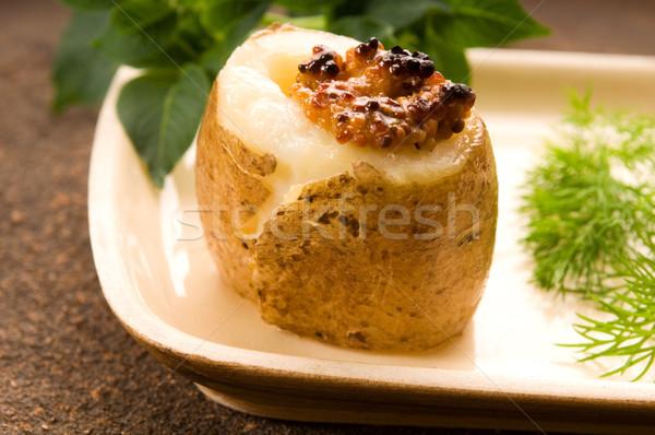 Baked potato with sour cream, grain Dijon mustard and herbs Stock photo © joannawnuk