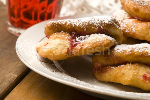 Dough with marmelade on wooden board Stock photo © joannawnuk