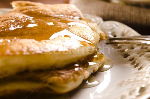 Palacsinták szirup tányér reggeli csésze desszert Stock fotó © joannawnuk