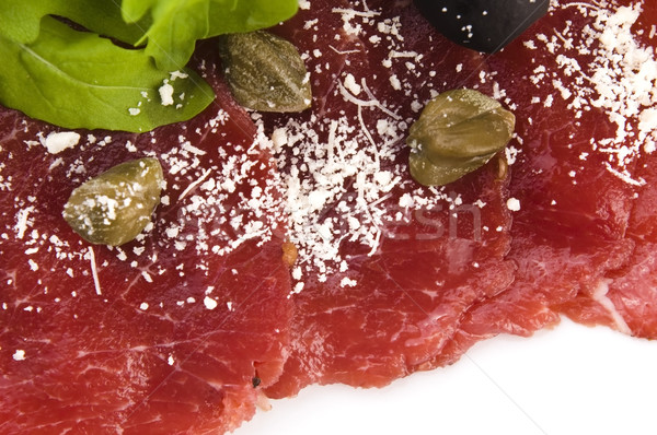 Beef carpaccio with rucola and parmesan  Stock photo © joannawnuk