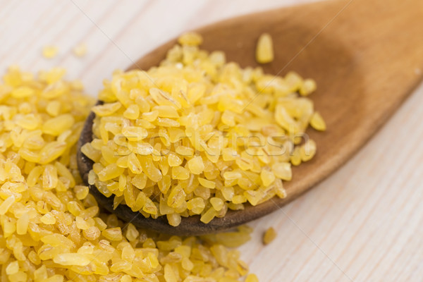 bulgur wheat in wooden spoon Stock photo © joannawnuk